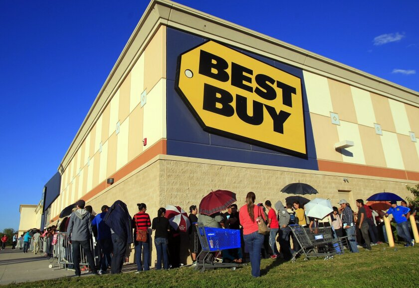 FILE - In this Nov. 27, 2014 file photo, customers stand in line as they wait for the doors to open at Best Buy in McAllen, Texas. Best Buy's fiscal second-quarter results handily beat analysts' estimates as shoppers picked up major appliances, large screen televisions and mobile phones. The stock surged more than 11 percent in premarket trading Tuesday, Aug. 25, 2015.(AP Photo/The Monitor, Gabe Hernandez)