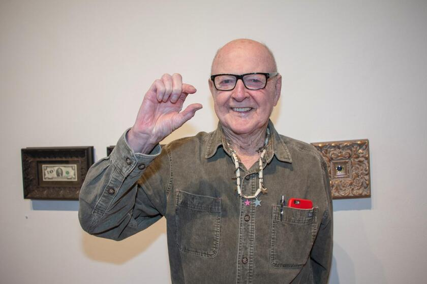 Robert Matheny with his three small pieces at the opening