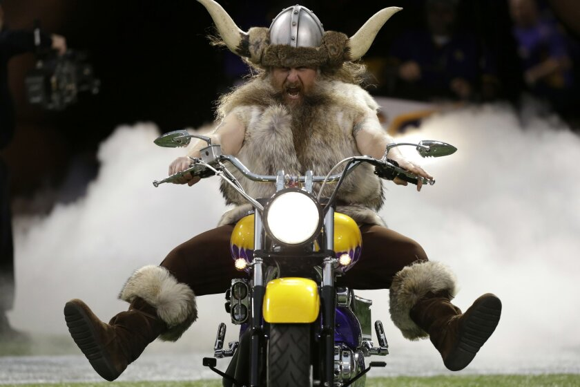 "FILE - In this Nov. 11, 2012, file photo, Minnesota Vikings mascot Ragnar the Viking rides onto the field before an NFL football game between the Vikings and the Detroit Lions in Minneapolis. The Vikings said Monday, Sept. 21, 2015, their contract with Joe Juranitch, the man who played Ragnar, expired during the offseason. The team says it has had ""multiple conversations"" with Juranitch but has not been able to reach an agreement on his role with the Vikings. (AP Photo/Charlie Neibergall, File)"