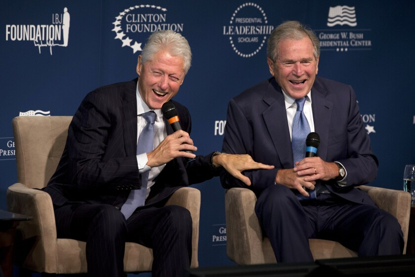 Former Presidents Bill Clinton and George W. Bush at the Newseum in Washington last year. The 2016 election could put yet another Bush or Clinton in the White House.