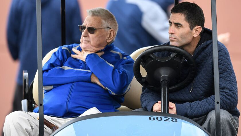 Don Welke, vice president of scouting operations, and Padres' General Manager A.J. Preller, right, watch a workout at the Peoria Sports Complex on Feb. 21, 2018 in Peoria, Arizona.