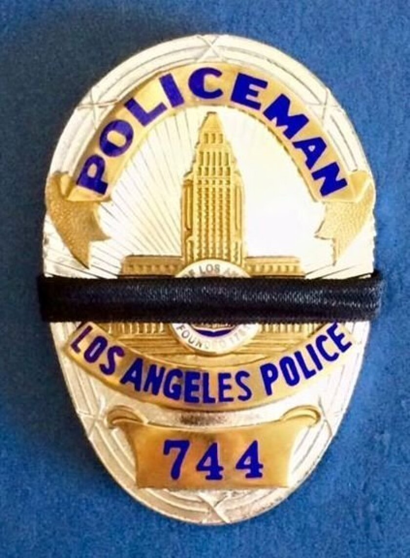 "The Los Angeles Police Reserve Foundation posted a badge online bearing a black band and the number of Officer Pete Malloy, the ""Adam-12"" cop played by Martin Milner who died Sunday."
