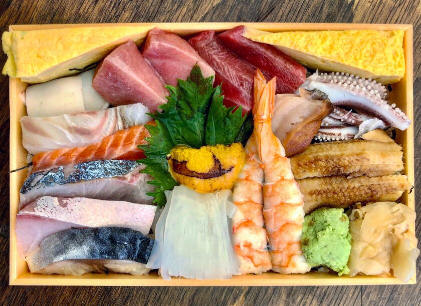 A box of chirashi from Sushi ii.
