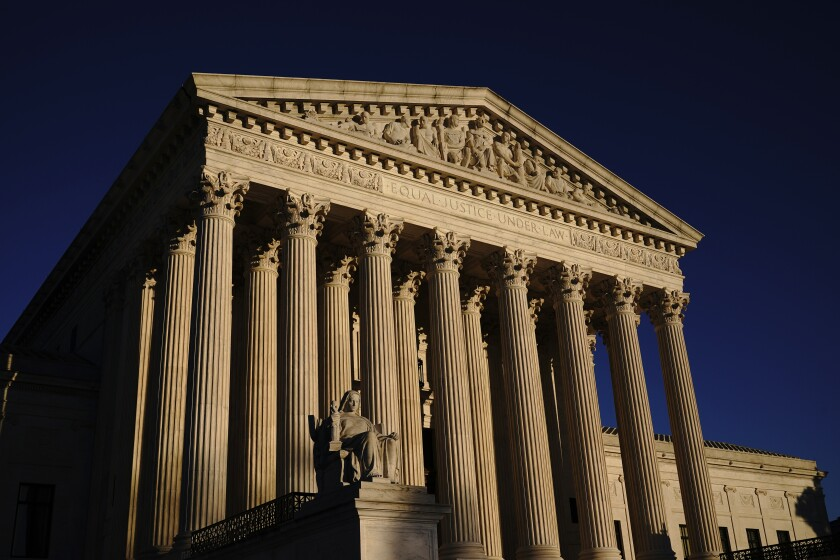 Exterior view of the Supreme Court columns and statue.