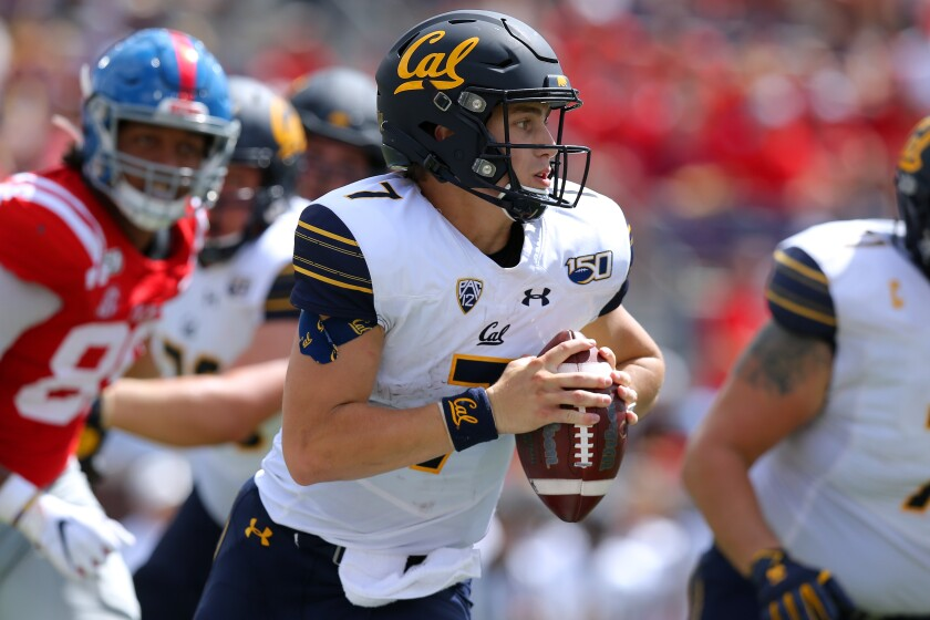 California quarterback Chase Garbers runs with the ball against Mississippi on Saturday in Oxford, Miss.