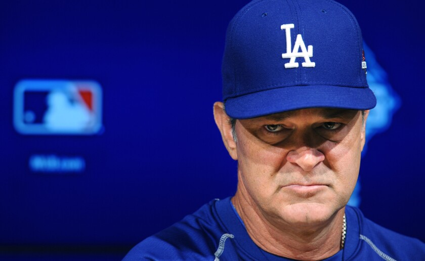 Dodgers Manager Don Mattingly answers questions during a new conference before his team's National League division series matchup with the New York Mets.