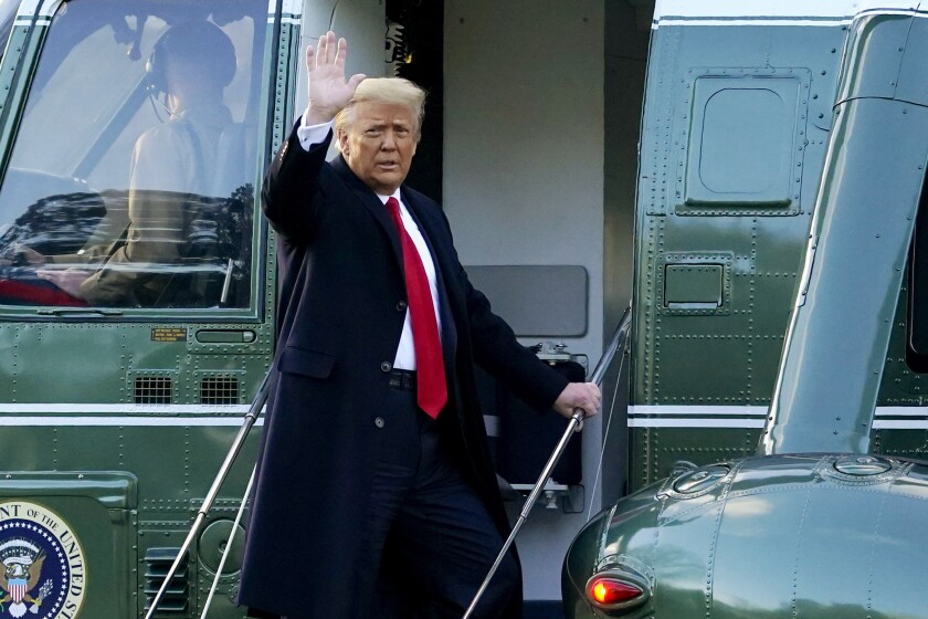 President Trump waves as he boards Marine One