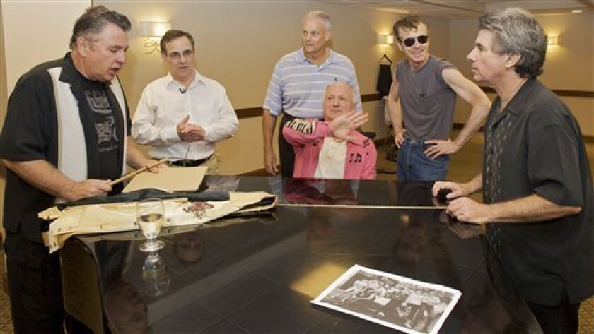 In this Sept. 24, 2010 photo, the Doo-Wop group Sha Na Na rehearses for their special performance to mark the 75th anniversary of Hofstra University in Melville, N.Y. From left are Jocko Marcellino; Robert Leonard; Donny York; Screamin' Scott Simon; David Garrett; Donny York and Elliot Cahn. (AP Ph