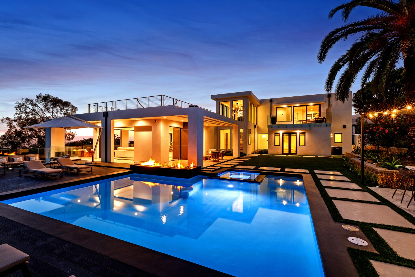 The newly-finished home near Zuma Beach is geared for indoor-outdoor living with pocketing walls, wrap-around terraces, balconies and a rooftop deck. Listed for $12 million, the contemporary-style house includes such amenities as a gym, movie theater and outdoor kitchen. Five bedrooms and six bathrooms are spread across two floors. Inside, some 6,500 square feet of interior features polished cement floors, artistic walls and a floating staircase. Walls of glass take in sweeping ocean views.
