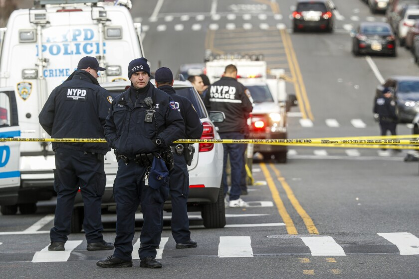 New York City police officers at the scene of a police-involved shooting.