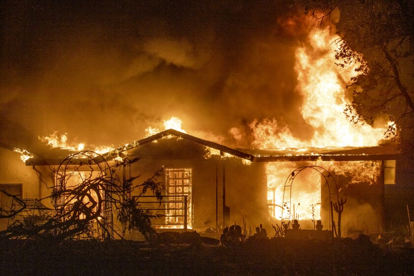 A house burns on Platina Road at the Zogg Fire near Ono, Calif.