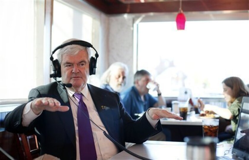Republican presidential candidate, former House Speaker Newt Gingrich speaks during a radio interview in the Hollywood Diner in Dover, Del., Thursday, April 12, 2012. (AP Photo/Patrick Semansky)