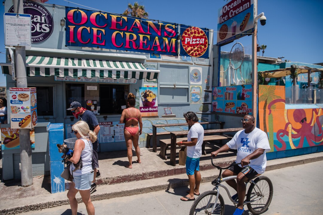 People line up in front of Ocean's Ice Cream on July 5, in Pacific Beach, California.
