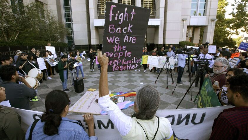 FILE - In this June 20, 2018, file photo, protesters demonstrate outside the federal courthouse in S
