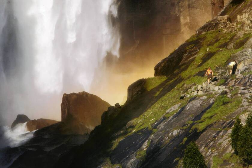 Vernal Fall is one of Yosemite National Park's most popular spots. A summer day can see 2,000 visitors. Above, hikers make their way up the Mist Trail leading to the top of Vernal Fall in 2009.