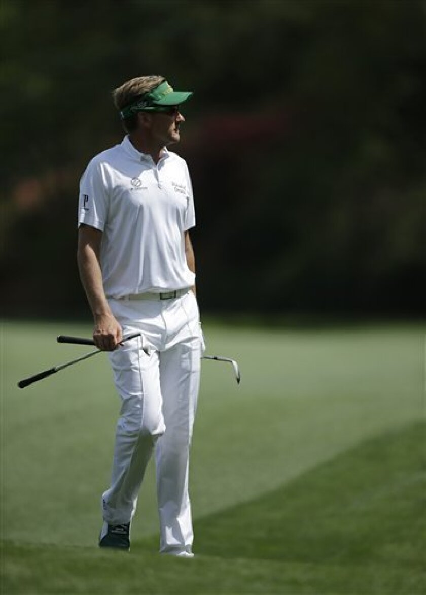 Ian Poulter, of England, walks down the 13th fairway during a practice round for the Masters golf tournament Monday, April 8, 2013, in Augusta, Ga. (AP Photo/Matt Slocum)