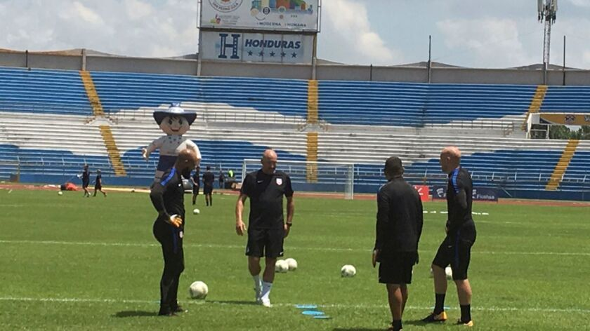 U.S. soccer goalkeepers Tim Howard, left, Nick Rimando, second from right, Brad Guzman, right, and goalkeeper coach Matt Reis practice Monday at Estadio Olimpico Metropolitano in San Pedro Sula, Honduras.