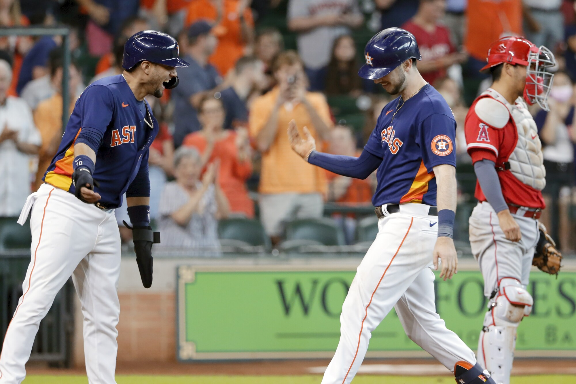 Houston's Kyle Tucker, right, celebrates with teammate Yuli Gurriel after hitting a two-run home run.