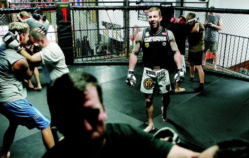 Todd Vance, an Army vet, teaches a mixed martial arts class at the Undisputed gym in North Park in October.