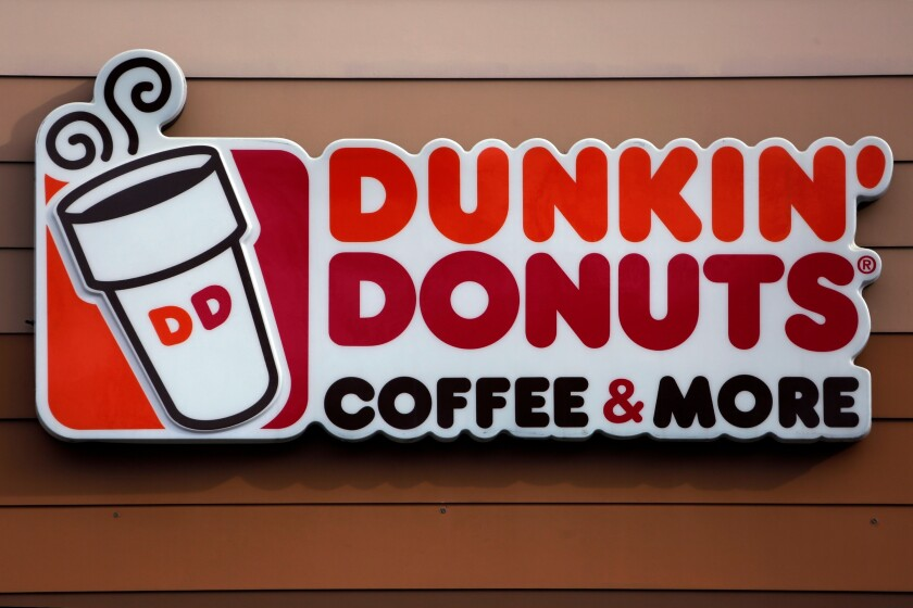 FILE - This Jan. 22, 2018, file photo shows a Dunkin' Donuts logo on a shop in Mount Lebanon, Pa. The Massachusetts-based coffee and donuts empire is teaming with Post Consumer Brands to release two new breakfast cereals based on two of its most popular coffee drinks: Caramel Macchiato and Mocha Latte. The new cereals are expected to hit grocery shelves in late August 2020. (AP Photo/Gene J. Puskar, File)