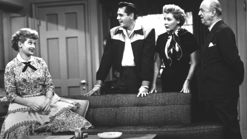 """Lucille Ball, left, appears in a scene from """"I Love Lucy"""" with cast members Desi Arnaz, Vivian Vance and William Frawley."""