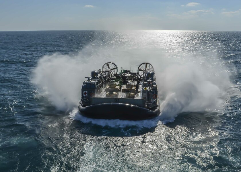 A landing craft air cushion approaches the well deck of the amphibious assault ship Boxer in the Persian Gulf. Boxer is the flagship for the Boxer Amphibious Ready Group, with the embarked 13th Marine Expeditionary Unit.
