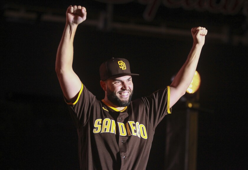 Eric Hosmer shows fans one of the Padres' new uniforms during uniform unveiling event at Petco Park on Saturday, November 9.