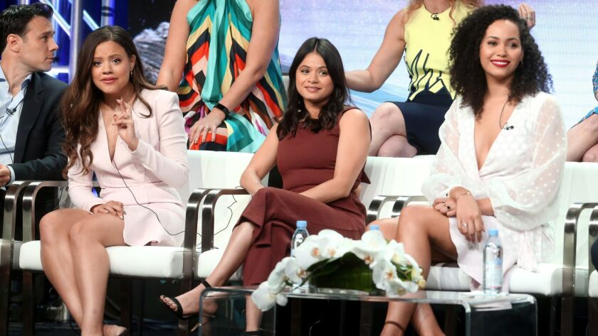 "Sarah Jeffery, from left, Melonie Diaz and Madeleine Mantock, who play the new witches in the ""Charmed"" reboot, speak onstage at the CW Network portion of the Summer 2018 TCA Press Tour at the Beverly Hilton Hotel."