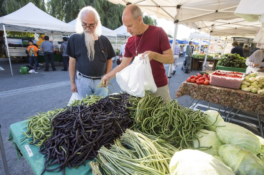 String beans and long beans grown by Changseng Thao in Sanger, at the Encino farmers market.