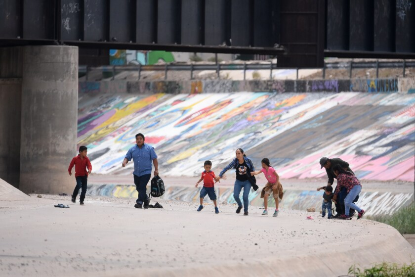 Migrants cross into the U.S. from Ciudad Juarez, Mexico