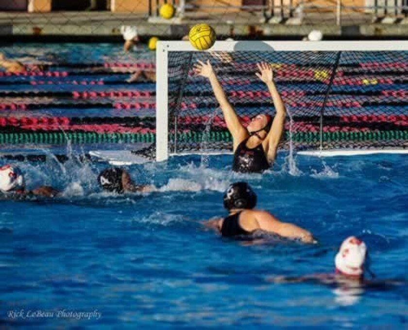 La Jolla Vikings' Lauren Silver deflects a shot over the crossbar. (Photo by Rick LeBeau)