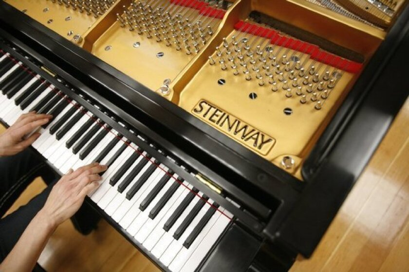Steinway, maker of pianos, sold for $512 million to hedge fund