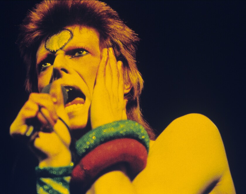 David Bowie performs at Earls Court Arena on May 12, 1973, during the Ziggy Stardust tour.