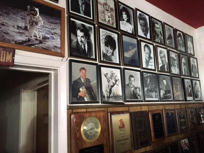 The 'Wall of Fame' bears autographed photos of celebrity customers who have visted Pernicano's Family Restaurant in Pacific Beach.
