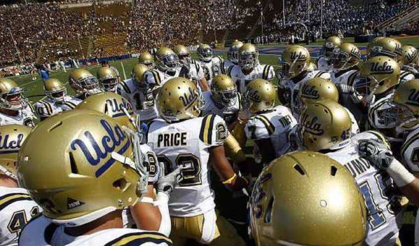 UCLA football players take the field at California Memorial Stadium in Berkeley in 2010.