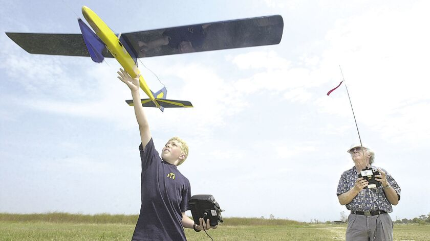 DPT.FLYERS-1.053003.SH JakeWirtz,11, a Talbert Middle School student launches a glider with the assi