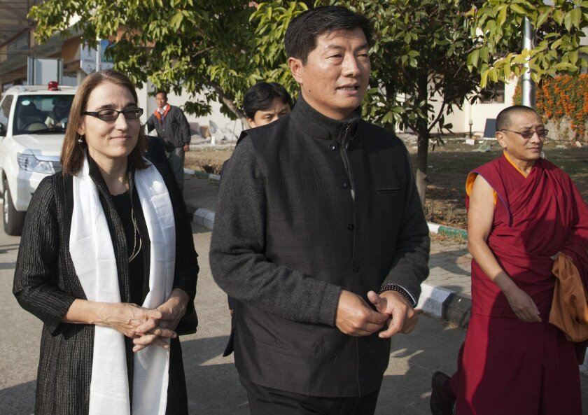 Lobsang Sangay, prime minister of Tibet's government in exile, walks with Sarah Sewall, U.S. undersecretary of State for civilian security, democracy and human rights, during a meeting in Dharmsala, India, on Jan. 15.