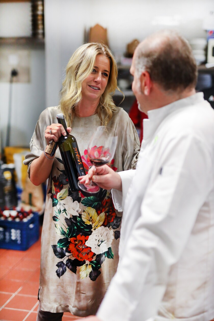 Marina Snow of DOCG Imports in San Diego shares one of the natural wines she imports from Italy with chef Silvio Salmoiraghi, a Michelin-starred chef from Milan who has been hired to revolutionize the menu at Ambrogio15 pizzeria in San Diego.