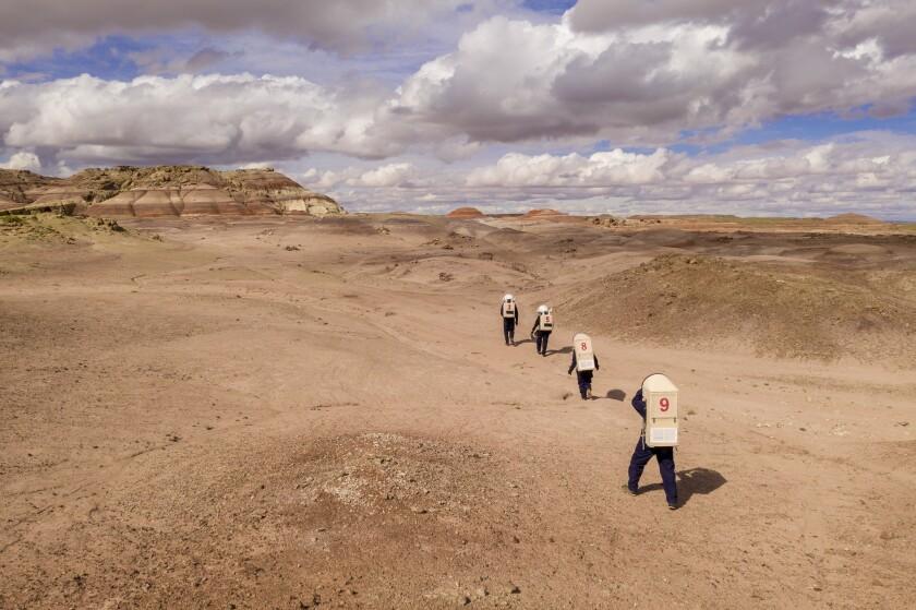 HANKSVILLE, UTAH -- FRIDAY, MAY 10, 2019: Members of MRDS Crew 212 walk out into the Utah desert to