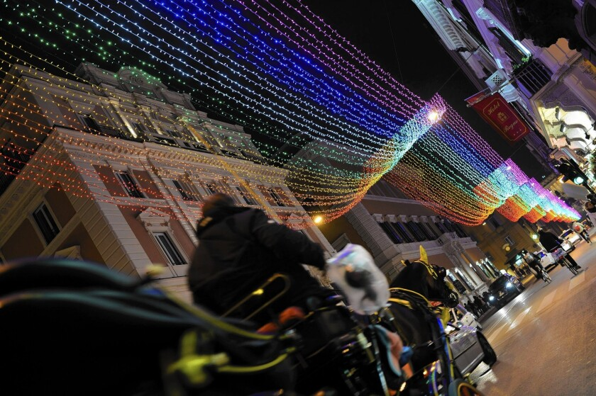 "Rainbow lights line one of Rome's main shopping streets last month. ""I can do whatever I want in the city center of Rome, but ... people in the suburbs [and in other cities] continue to live hidden,"" one man said."