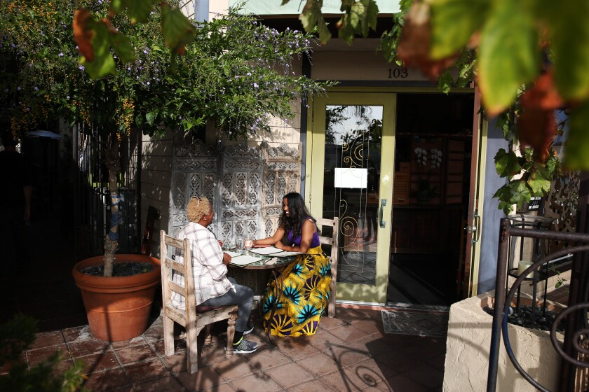 Barbara Dixon, left, dines with Autumn Jones at the Green Temple in Redondo Beach.