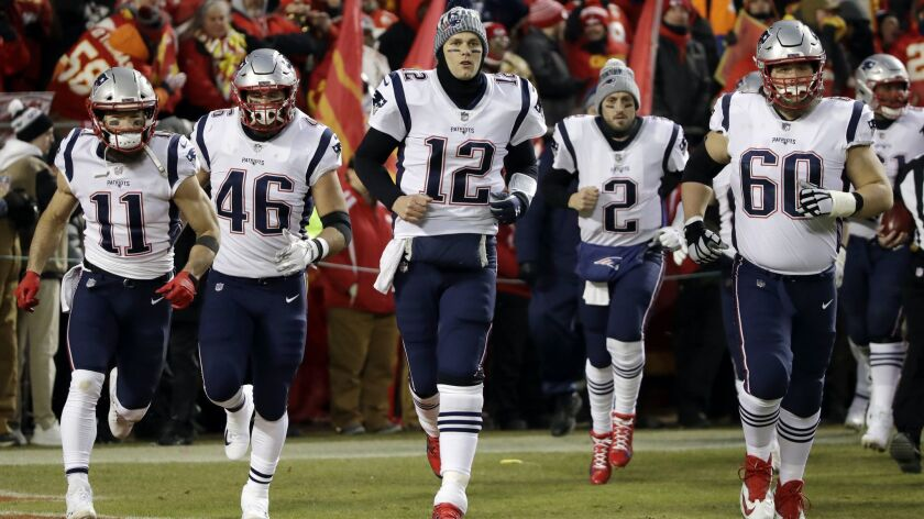 New England Patriots quarterback Tom Brady (12) leads his team onto the field for the AFC Championship against the Kansas City Chiefs on Sunday.