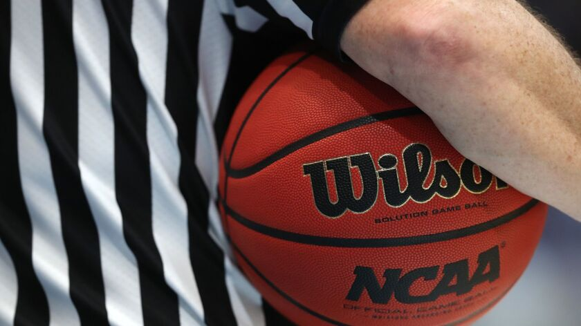 A referee holds a game ball during the 2019 NCAA Men's Basketball Tournament in Hartford, Conn. on March 21.