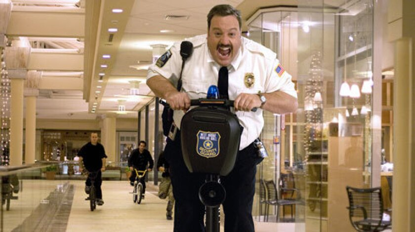 STOP! MALL POLICE! Paul Blart (Kevin James) tries to slow down a rascally shopper. The movie, which James co-wrote, has much physical comedy.