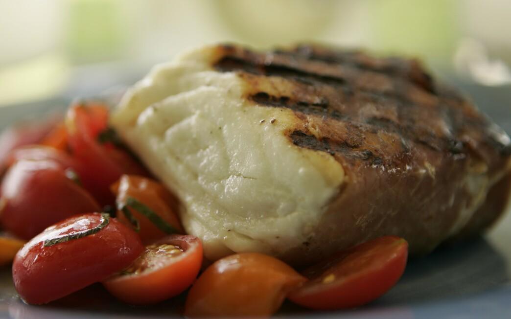 Prosciutto-wrapped halibut with grape tomato salad