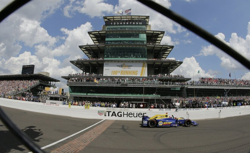 Alexander Rossi crosses the finish line to win the 100th running of the Indianapolis 500 auto race at Indianapolis Motor Speedway in Indianapolis, Sunday, May 29, 2016. (AP Photo/Darron Cummings)