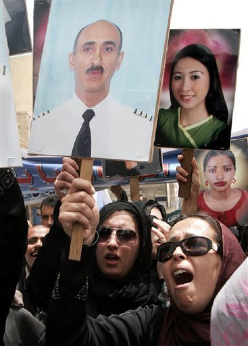 Yemeni colleagues of the crew of the Yemenia Airways Flight 626 , which crashed off the Indian Ocean archipelago of Comoros last week, protest outside the French embassy in San'a, Yemen, Wednesday, July 8, 2009. Relatives of the crew and Yemenia airways staff protested against the French search and investigation operation which they say was slow. (AP Photo)