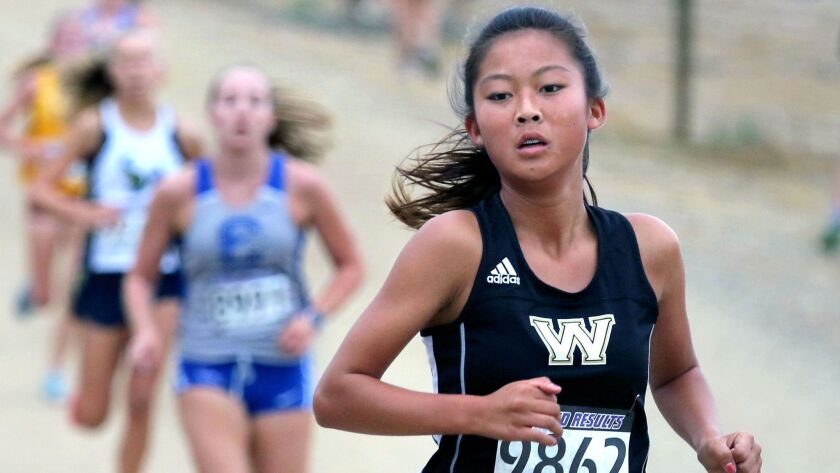 Westview's Trang Woolridge leads the pack at Guajome Park.