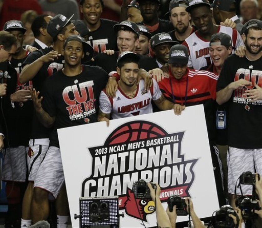 Louisville players celebrate after defeating Michigan 82-76 after the second half of the NCAA Final Four tournament college basketball championship game Monday, April 8, 2013, in Atlanta.(AP Photo/Chris O'Meara)