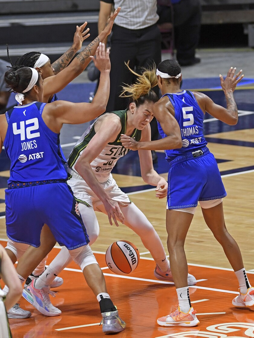 Storm forward Breanna Stewart, center, loses the ball under pressure from Connecticut Sun defenders Emma Cannon, back left, Brionna Jones (42) and Jasmine Thomas (5) in the second half of a WNBA basketball game Sunday, June 13, 2021, at Mohegan Sun Arena in Uncasville, Conn. (Sean D. Elliot/The Day via AP)